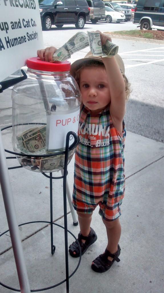 little boy donating 2